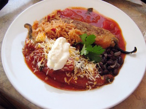 Peeled and sauced chiles rellenos as served in Albuquerque.