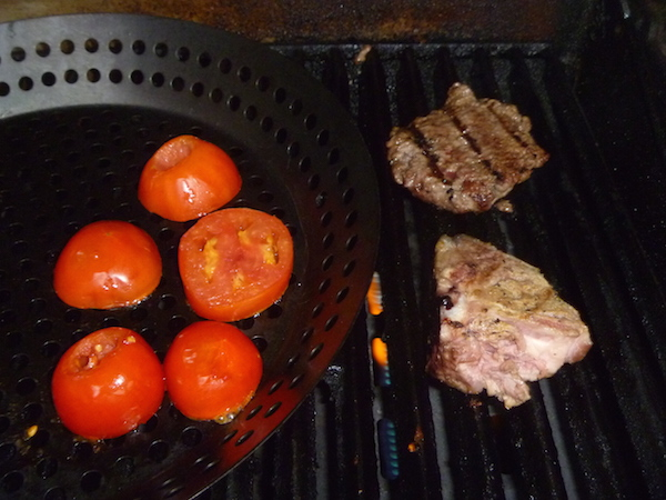 Grilling the tomatoes in my special skillet.